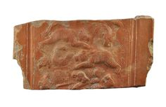 Roman terra sigillata plate fragment with bears, 4th-5th century A.D. African red slip ware plate fragment, North Africa, with bears fighting, 17.9 cm long. Private collection