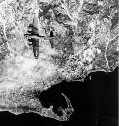 Boeing B-17 Flying Fortress, perhaps of 97th Bomb Group, USAAF, bombing Messina, Sicily, summer 1943. Messina, a great strategic target, note the harbour, which was heavily bombed in preparation of Allied invasion of Sicily, Operation Husky, and of the crossing of the Straits for passage of Allied forces in continental Italy.