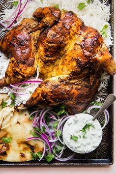 Warm spices like ginger, turmeric, cinnamon and cumin mixed with yogurt make the marinade for this simple whole tandoori roast chicken. Tandori Chicken, Comida India, Whole Roasted Chicken, Good Food, Yummy Food, Cooking Recipes, Healthy Recipes, Meat Recipes, Vegetarian Recipes