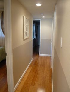Two-tone hallway. Love this. Olympic paint colors: Gray Beige and Stonington.