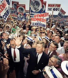 Arriving in Los Angeles on July 9, 1960, for the Democratic National Convention, Sen. John F. Kennedy makes his way through a crowd of supporters and journalists.