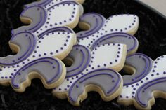 Awesome cute Mardi Gras Fleur De Lis Cookies, from 4theloveofcookies on Etsy.