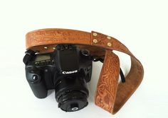 Turn a tooled vintage belt into a one-of-a-kind camera strap with this DIY.