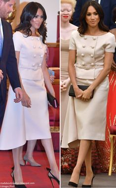 Meghan wore bespoke Prada ensemble for the Queen's Young Leaders awards 6/26/2018. The pale pink suit features a peplum effect top, a thin waist belt, button detailing and an asymmetrical skirt.