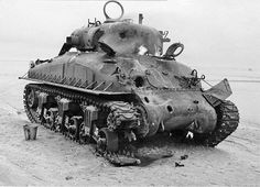 A U.S. Sherman tank pounded to death by German anti tank rounds, Normandy, France.