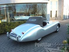 """Jaguar XK 120 Alloy  1950 for sale 2. The \""""120\"""" in the name referred to the aluminium car's 120 mph (193 km/h) top speed (faster with the windscreen removed), which made it the world's fastest production car at the time of its launch.  Before production switched to all steel in 1950, 242 examples were produced in aluminium. This XK120 Roadster is one of them. Understandably, today a very sought after collectors car!"""