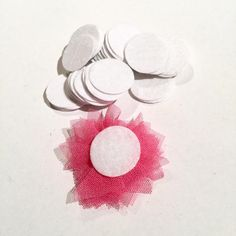 1 inch white die cut felt circles. Hundreds of elastics, FOE, flowers, rhinestones, jewelry findings & more too!
