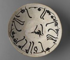 Bowl Inscribed with a Saying of 'Ali ibn Abi Talib Vessel 10th century Samanid period, AH 204-395 / AD 819-1005 Creation Place: Nishapur, Iran Reddish earthenware covered in white slip and painted with black (manganese and iron) under clear lead glaze 6.1 x 21.5 cm (2 3/8 x 8 7/16 in.)