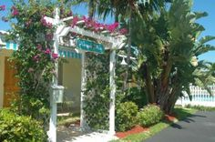 Pet Friendly Pineapple Place Apartments-Pompano Beach:  Pineapple Place is a small, well-kept property just across A-1-A Ocean Blvd. from one of South Florida's most pristine, award-winning Blue Wave beaches with lifeguards, a fishing pier and lighthouse. This White Glove Award-winner is rated nationally as a Superior Small Lodging. Enjoy one and two-bedroom apartments along with sparkling swimming pool, BBQ area and tropical landscaping.
