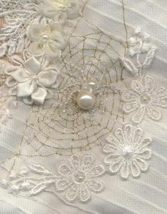 White on white crazy quilt with bead spider:
