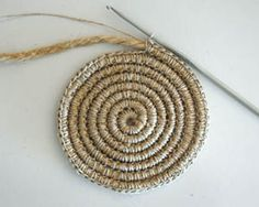 Crochet around rope or yarn to make rugs, baskets, trivets, etc. Faster than braided or sewn rag-rug method.