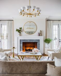 White Transitional Fireplace Design With Gray Marble Surround Tile Round Mirror Over The