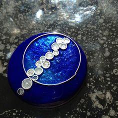 Handmade cloisonne enamel pendant with fine silver wire and leaf. Amanda Lloyd Designs (www.etsy.com/shop/amandalloyddesigns)