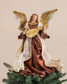 Add a captivating touch of warmth to your holiday display with our Bronze and Gold Christmas Angel Tree Topper. Exclusively from Balsam Hill. Christmas Tree Tops, Angel Christmas Tree Topper, Black Christmas, Angel Ornaments, Christmas Angels, Rustic Christmas, Tree Decorations, Christmas Decorations, Christmas Themes