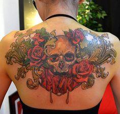 Skull and roses tattoo on black