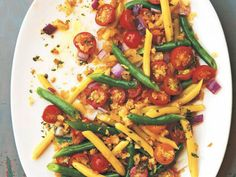 Fresh tomato salads are, in my opinion, one of the greatest joys of summer eating. They're even better when you can use tomatoes you've picked yourself. In her new Kitchen Garden Cookbook, Jeanne Kelley pairs this staple of a summer garden with snappy green beans and pale yellow wax beans for a crunchy, colorful twist. A generous shower of herbed bread crumbs adds more texture to the salad, turning it into a dish akin to a light panzanella.