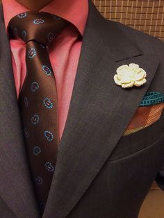 This kind of colour savvy would hypnotize me. The shirt looks like Soft Season coral (gorgeous as a nude lipstick on a woman), the jacket Soft Summer mauve-brown. The tie has more orange, might be Soft Autumn, and it settles in to the composition. The pocket square is more Autumn. The flower, maybe his daughter made that at school, is too yellow for the outfit and stands out, but hey, my kid made it. This is like doing an analogous colour scheme using the Season wheel instead of the colours.