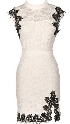 Ciao Bella Dress: Features an elegant high-neck with a sheer lace yoke and sexy open-back, bold black crochet trim highlighting every edge, fully lined body for no show-through, and a sexy slit at the hem to finish.