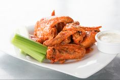 Artego Pizza KC -  One of our most popular appetizers --- jumbo chicken wings glazed in our signature garlic buffalo sauce. @W39thKC