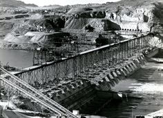 """Learn more: Completed in 1941, The GRAND COULEE DAM was the biggest hydroelectric power producing facility in the world. Woody was commissioned to write about the project put forth by the Works Progress Administration:   """"Well, the world has seven wonders that the trav'lers always tell, Some gardens and some towers, I guess you know them well, But now the greatest wonder is in Uncle Sam's fair lang,It's the big Columbia River and the big Grand Coulee Dam."""""""