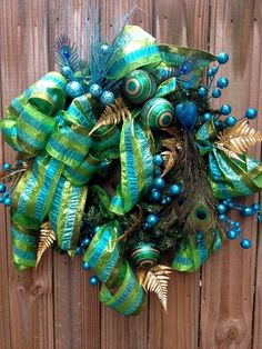 Teal and Lime Green Peacock Christmas Wreath by regina