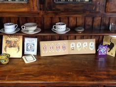 Antique tea leaf reading cups and tarot cards