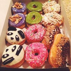 California Donuts - Los Angeles, CA, United States. Left to right, from the top: blueberry cinnamon toast crunch, matcha green tea, lucky charms, panda, sprinkles, snickers