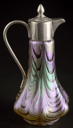 South Boheminan carafe/claret jug made of clear glass decorated with print and combed design and a rainbow surface, mounted in white metal by Wilhelm Kralik Sohne, Lenora, after 1900