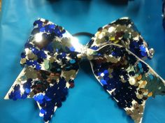 """3"""" reversible sequin cheer bow, royal blue and silver sequins on white grosgrain ribbon."""