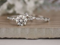 ****Engagement Ring Details**** 14k Solid White Gold (Also can be made in White and Yellow Gold, Please select your choice At Checkout) 2-2.2mm (Approximate Band Width) Diamond Milgrain Band Natural Moissanite (Center Stone) Round 8mm (Dimensions of Center Stone) 1.80carats (Average