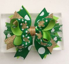 St. Patricks Day is around the corner and what better way to avoid getting pinched by wearing our new green lucky bow.  • Approximately 5 inches • All ribbons are heat sealed to prevent fraying. • This bow is attached an alligator clip (can be changed in French Barrette clip upon request )  Like my Facebook page & follow my work  www.facebook.com/AurorasChicBowtique  Instagram : auroras_bowtique