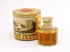 1906 Guerlain Apres L'Ondee perfume bottle and stopper, clear glass, gilt detail (tiny loss in drape-visible in photo), label, box (split hinge). 3 in.
