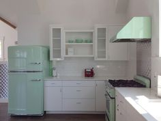 Big Chill appliances in mint green. I love this kitchen!