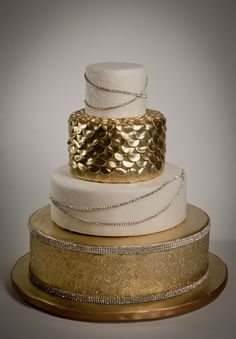 Glamorous gold wedding cake by Sugar Couture