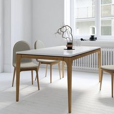 The Lars dining table epitomizes modern Nordic functional design. Clean cut solid American oak wood provides a sturdy foundation, topped with white powder coated German MDF for a clean finish. This generous space seats chairs with ample room for a feast. Dining Room Table Chairs, Dining Table In Kitchen, Dining Furniture, Home Furniture, Contemporary Dining Sets, Window Seat Kitchen, Interior Design, Home Decor, Kitchen Products