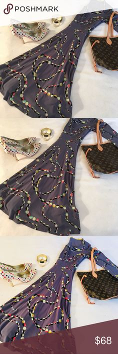 Boden Gray Dot Chain Link Fit-n-Flare Dress 6 Super cute gray  dress with beautiful Multi dot Chain Link design in excellent like new condition. Perfect addition to any preppy and stylish wardrobe. *The color is gray not purple. Boden Dresses Midi