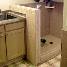 Utility room washer & dryer area-rinse children's dirty feet or wash the dogs instead of having a utility sink! Hang clothes rack above for drip dry clothes or towels!