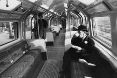 A London Underground official drinking a cup of coffee during trials of new automatic trai...