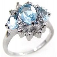 Shop from the world's largest selection and best price for 2.15ctw Genuine Blue Topaz Sterling Silver Engagement Rings. Shop with confidence on SterlingSilverJewelry.tv! Buy Now: http://www.sterlingsilverjewelry.tv/genuine-blue-topaz-925-sterling-silver-gemstone-ring-sjr10130bt.html