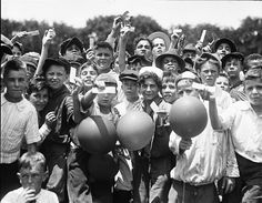 Boys from the Boys Club with captured balloons which were released from White House with tickets attached for a Washington-St. Louis game, 1922.