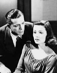 """Dana Andrews and Gene Tierney in """"Laura"""" Gene Tierney in my opinion, was probably the most beautiful woman of her time.   I loved this movie."""