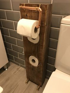 lovely idea single post toilet paper holder. Bespoke toilet roll holder  Made from a railway sleeper and copper fittings Bowley Jackson Antique design vintage
