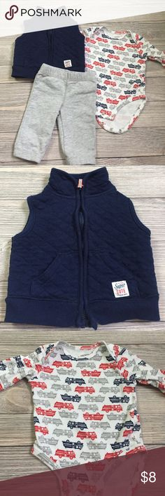 Carter's 3 Piece Outfit Carter's 3 Piece Firetruck Outfit.   Navy blue zip up vest, long sleeve Firetruck onesie, grey sweat pants.  Excellent condition.  Smoke free/pet free home. Carter's Matching Sets