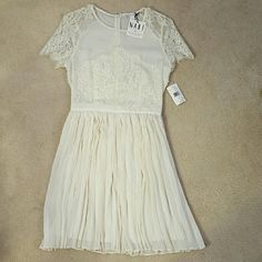 "FLASH SALE! NWT Elegant white lace dress Gorgeous lace detail and flowy pleats on bottom. Off white/cream color. It's an A-line fit so it's very forgiving if you're not comfortable with your bottom half. Perfect for a rehearsal dinner, bridal shower, bachelorette, any wedding festivity, or overall summer dress! I'm 5""4 for pic reference. I ended up wearing another dress instead and I'm trying to save, otherwise I would keep it!  Make me an offer! All my prices are negotiable :) Macys Dresses…"