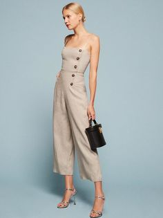 How to wear clothes without feeling like you're wearing clothes. This is a wide leg jumpsuit with a straight neck and side button detail.