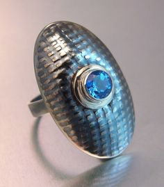 Melody Armstrong, Canada. Ice Blue Topaz ring.