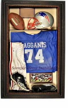 Football display case for ball, jersey, cleats, helmet, photos, and more. $795