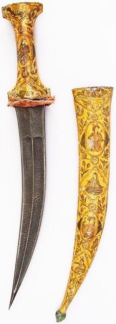 Indian jambiya dagger, 19th century, iron, enamel, velvet, H. with sheath 18 3/8 in. (46.7 cm); H. without sheath 18 1/4 in. (46.4 cm); H. of blade 13 in. (33 cm); W. 5/16 in. (0.8 cm); D. 1 3/16 in. (3 cm); Wt. 15.2 oz. (430.9 g); Wt. of sheath 9.9 oz. (280.7 g), Met Museum.