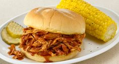 Sit down at the end of the day to an effortless meal of tender pulled chicken slow cooked in a sweet and smoky sauce and served on a bun.