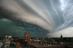 A shelf cloud is a low, horizontal, wedge-shaped arcs cloud, attached to the base of the parent cloud, which is usually a thunderstorm. The underside often appears turbulent and wind-torn. Cool, sinking air from a storm cloud's downdraft spreads out across the land surface, with the leading edge called a gust front. This outflow cuts under warm air being drawn into the storm's updraft.